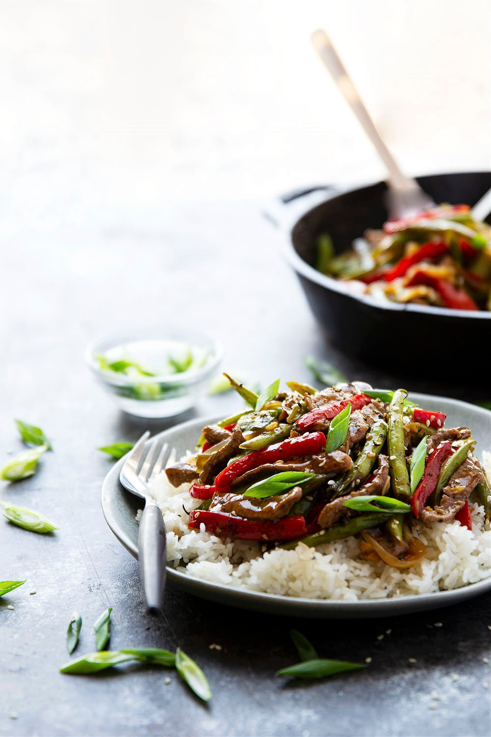 Restaurant-style black pepper beef is loaded with juicy beef strips, tender veggies, and coated in a sticky ginger black pepper sauce.