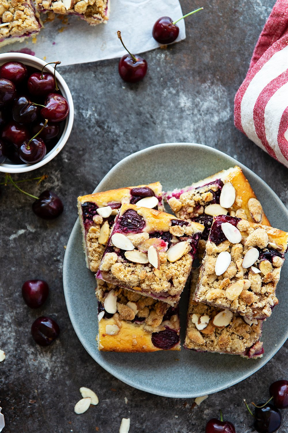 This almond cherry buckle features a soft buttermilk almond cake, a juicy sweet cherry filling, and a buttery almond streusel topping. - the best cake to make with in-season cherries!