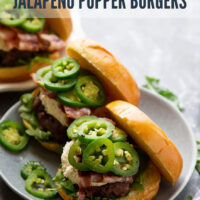 These bacon cheddar jalapeno popper burgers feature everything you love about the classic appetizer! Juicy burger patties are topped with crisp bacon, creamy cheddar cream cheese, and spicy sauteed jalapenos.