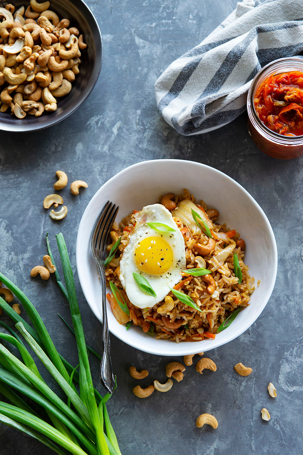 Flavorful kimchi and crunchy cashews take this kimchi cashew fried rice to the next level! Made easily in minutes with basic pantry ingredients and so much better than any takeout.
