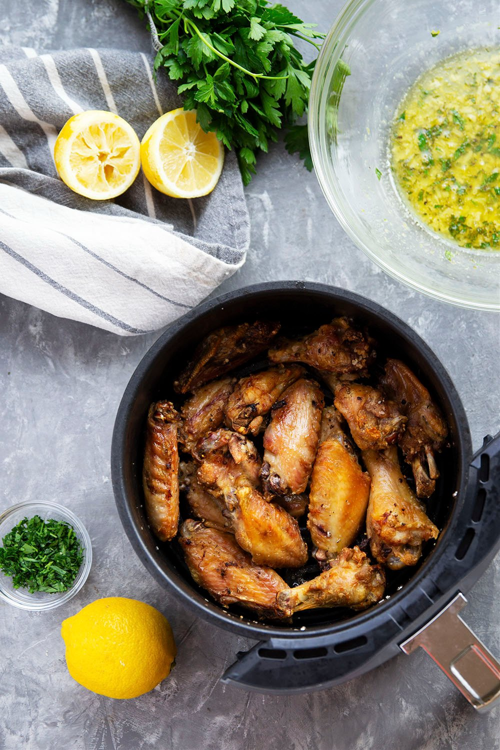 Made entirely in the air fryer and impossibly crispy, these lemon garlic chicken wings are a must-have addition to any appetizer table!