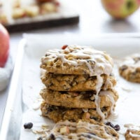 Oatmeal raisin apple cookies feature a perfectly soft oatmeal cookie base with chewy raisins, tender apple chunks, and a creamy spiced glaze.