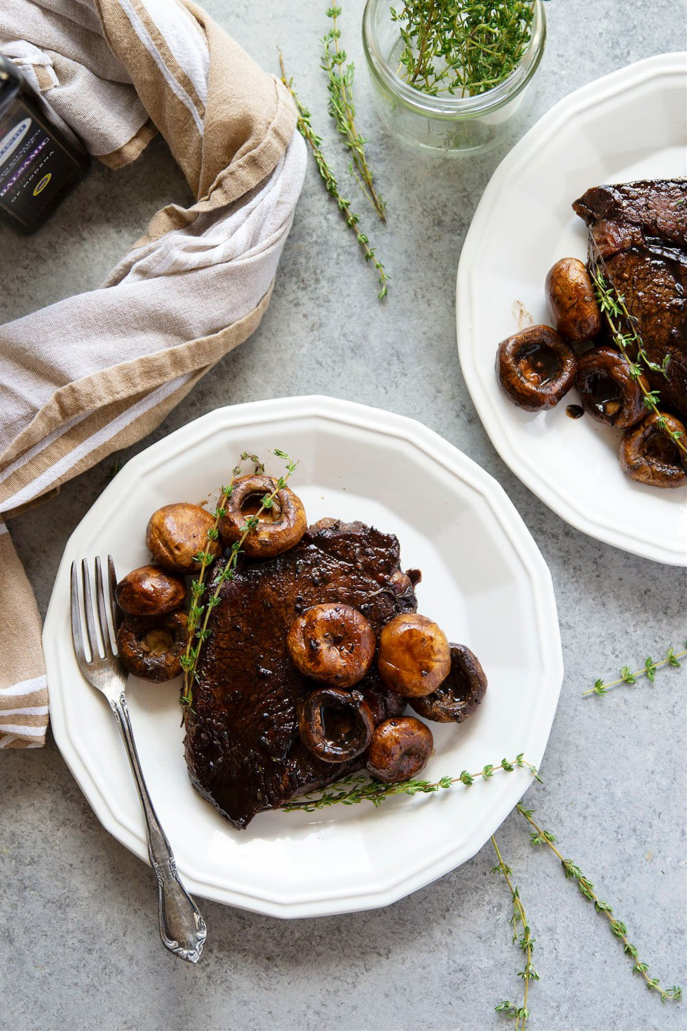 This balsamic glazed steak is made entirely in one skillet and features juicy seared steaks in a rich balsamic glaze with plenty of sauteed mushrooms on the side.