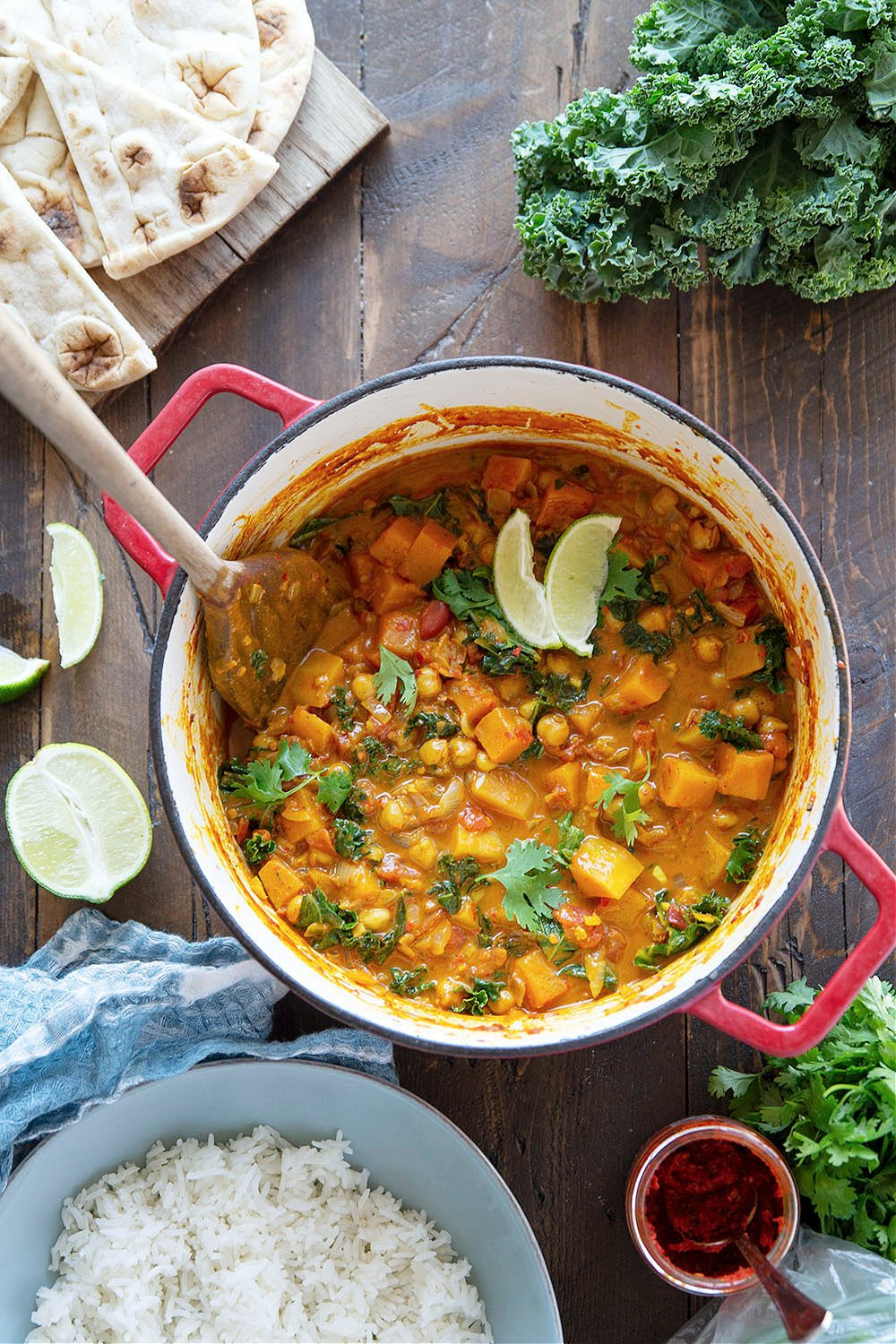 Loaded with soft butternut squash, tender chickpeas, and a punch of spicy harissa, this chickpea butternut squash curry is an incredibly hearty dinner that's vegan-friendly and easy to pull together on a weeknight.