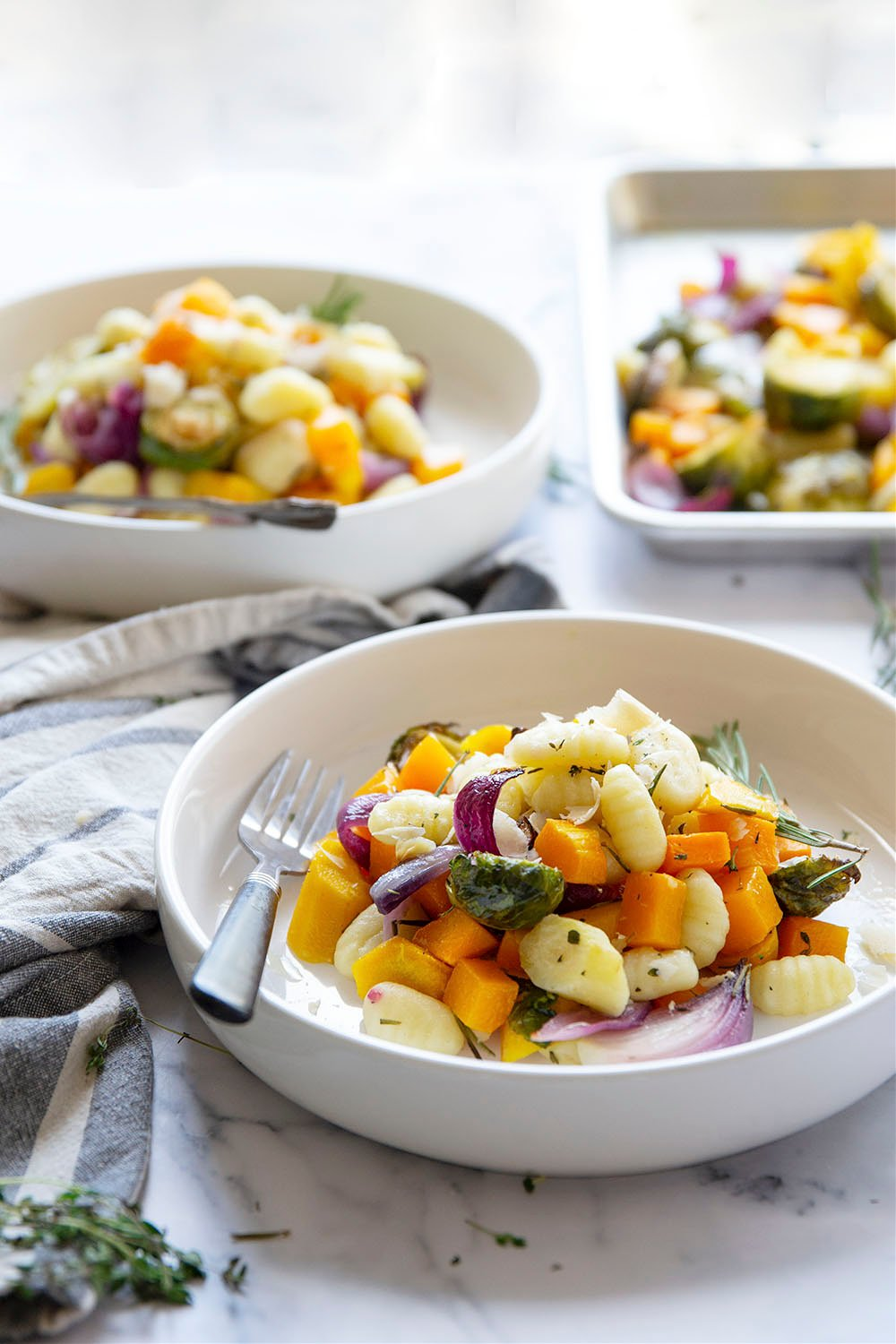 Sheet pan gnocchi is roasted with hearty fall vegetables entirely on one sheet pan in less than hour for an easy weeknight dinner with little to no cleanup!