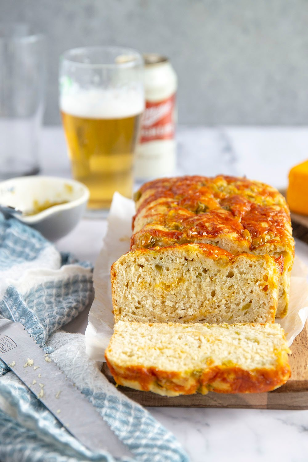 Green chile cheddar beer bread features spicy green chiles and gooey cheddar in a soft, flavorful beer quick bread that's perfect for snacking or a game day appetizer!