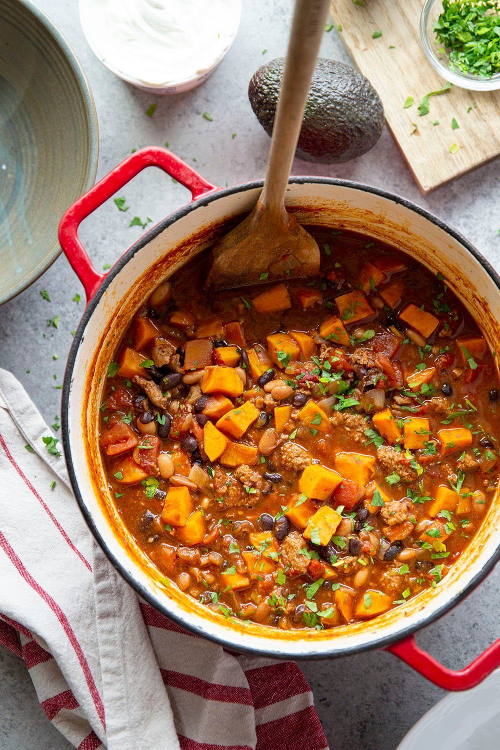 This chicken sweet potato chili packs a serious flavor punch! Packed with smoky chipotle peppers, ground chicken, tender sweet potatoes, and made easily in one pot.